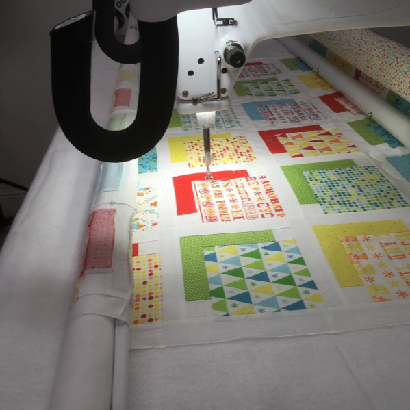 Customer quilt being quilted
