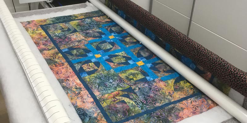 Customer wall quilt being quilted with curls and swirls pattern