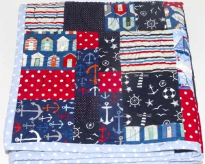 Ahoy-There-patchwork-cot-quilt-folded-Q000104