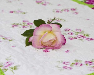 Cerise-cot-quilt-with-real-rose-Q000112