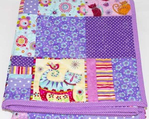 Cool-for-Purple-Cats-patchwork-cot-quilt-folded-Q000114
