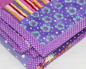 Cool-for-Purple-Cats-patchwork-cot-quilt-mitre-edge-detail-Q000114