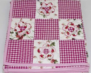Daisy-May-patchwork-cot-quilt-folded-Q000111