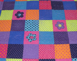 Dotty-About-You-patchwork-cot-quilt-detail
