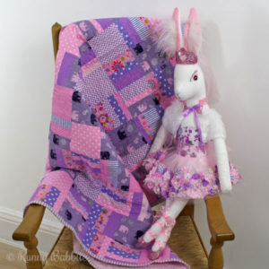 Elephants & Paisley quilt with Petunia Angora Heirloom Rabbit