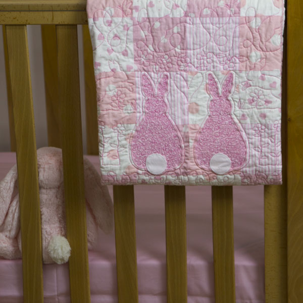 Runny-Babbits-cot-quilt-draped-over-cot-Q000124