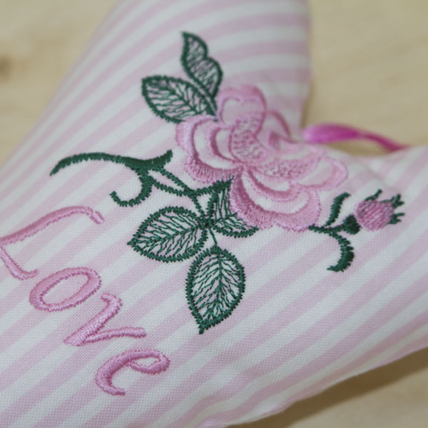 Love Heart single rose in pink close-up