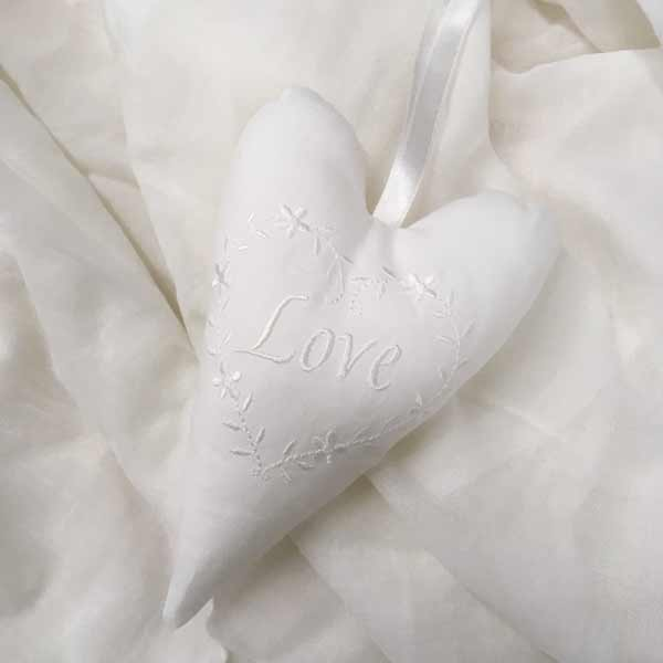 White embroidered Love in embroidered heart