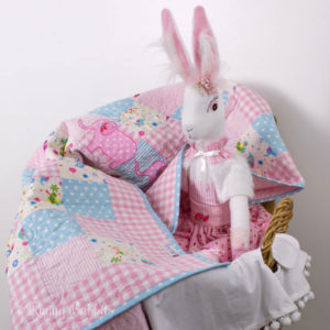Poppy Angora Rabbit with Elephant Trail Quilt